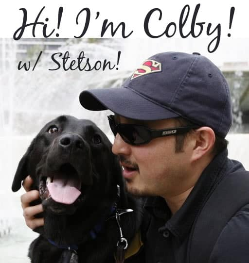 Colby and Stetson - Japanese man in hat and sunglasses with black Lab