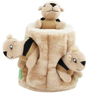 Plush dog toy. Cute brown squirrels in a wood stump.